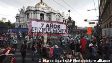The relatives of 43 missing university students hold a banner that reads in Spanish Seven Years Without Justice, as they protest the seventh anniversary of the student's disappearance, in Mexico City, Sunday, Sept. 26, 2021. Relatives continue to demand justice for the Ayotzinapa students who were allegedly taken from the buses by the local police and handed over to a gang of drug traffickers. (AP Photo/Marco Ugarte)