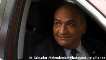FILE - In this May 3, 2021 file photo, Oscar Alberto Lopez Jerez, El Salvador's Supreme Court president, looks at journalists as he arrives at court in San Salvador, El Salvador. On Sept. 20, 2021, Lopez Jerez became one of five Supreme Court judges in El Salvador who the U.S. put on a list of people who undermine democracy through corruption, and is banned from traveling to the U.S. (AP Photo/Salvador Melendez, File)