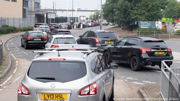 Cars line up at a petrol station in London
