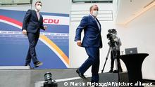 Candidate for chancellor of the Christian Union parties block Armin Laschet, right, parties Secretary General Paul Ziemiak leave a news conference at the Christian Democratic Union party headquarters in Berlin, Monday, Sept. 27, 2021. Following Sunday's election leaders of the German parties were meeting Monday to digest a result that saw Merkel's Union bloc slump to its worst-ever result in a national election and appeared to put the keys to power in the hands of two opposition parties. Both Social Democrat Olaf Scholz and Armin Laschet, the candidate of Merkel's party, laid a claim to leading the next government. (AP Photo/Martin Meissner)