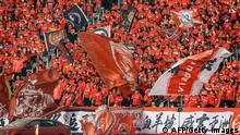 Supporters of Guangzhou Evergrande cheer for their team during the Chinese Super League (CSL) final football match between Guangzhou Evergrande and Jiangsu Suning in Suzhou in China's eastern Jiangsu province on November 12, 2020. (Photo by STR / AFP) / China OUT (Photo by STR/AFP via Getty Images)
