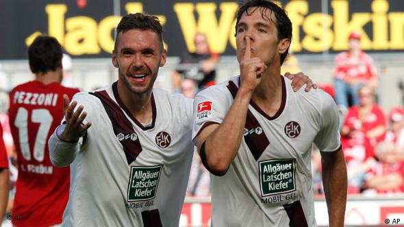 Kaiserslautern's Srdjan Lakic, right, celebrates scoring his side's first goal with his teammate Christian Tiffert during the German first division Bundesliga soccer match between FC Cologne and FC Kaiserslautern in Cologne, Germany, on Saturday Aug. 21, 2010. (apn Photo/Hermann J. Knippertz)