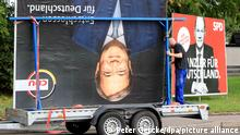 A CDU election poster is packed away