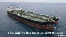 FILE - In this file photo released by the Indonesian Maritime Security Agency (BAKAMLA) on Jan. 24, 2021, Panamanian-flagged MT Frea, left, and Iranian-flagged MT Horse tankers are seen anchored together in Pontianak waters off Borneo island, Indonesia. Indonesian authorities said Saturday, May 29, that the two oil tankers were released after a four-month detention for illegally transferring oil in Indonesian waters. (Indonesian Maritime Security Agency via AP, File)