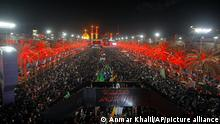 Shiite pilgrims gather between the holy shrines of Imam Hussein and Imam Abbas to celebrate the Arbaeen Shiite festival in Karbala, Iraq, Monday, Sept. 27, 2021. The holiday marks the end of the forty-day mourning period after the anniversary of the martyrdom of Imam Hussein, the Prophet Muhammad's grandson in the 7th century. (AP Photo/Anmar Khalil)