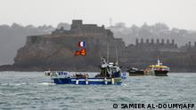 (FILES) In this file photo taken on May 6, 2021 French fishing boats protest in front of the port of Saint Helier off the British island of Jersey to draw attention to what they see as unfair restrictions on their ability to fish in UK waters after Brexit. - French government called for 169 vessels to be granted definitive access to British waters off Jersey before their existing temporary licences expired on September 30, 2021. (Photo by Sameer Al-DOUMY / AFP)