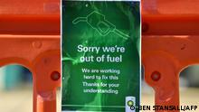 A sign outside a BP petrol station in Hildenborough, southeast England informs motorists that the station is closed due to a lack of fuel on September 24, 2021. - The UK government today urged the public against panic-buying as some petrol stations closed pumps due to a lack of lorry drivers to deliver fuel. (Photo by Ben STANSALL / AFP)