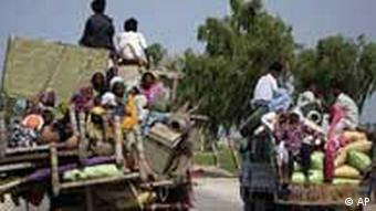 Pakistani villagers with their belonging travel to a safer place