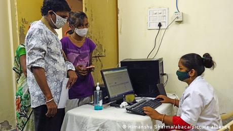 Indian People wait for verification on COWIN App for a dose of the Covishield Covid-19 coronavirus vaccine at a vaccination centre in Ajmer, Rajasthan, India