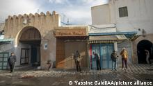 KAIROUAN, TUNISIA - DECEMBER 03: Men stand in front of closed stores as all tradesmen went on a strike on the call of the Tunisian General Workers Union (UGTT) and closed their workplaces in Kairouan, Tunisia on December 03, 2020. Tradesmen demanded from the ministries to fulfill their reform promises for the region. Yassine Gaidi / Anadolu Agency