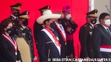 Peru's President Pedro Castillo (C) attends a ceremony for Armed Forces Day alongside Supreme Court President Elvia Barrios Alvarado (L) and Defense Minister Walter Ayala Gonzales, in Lima, Peru September 24, 2021. REUTERS/Sebastian Castaneda