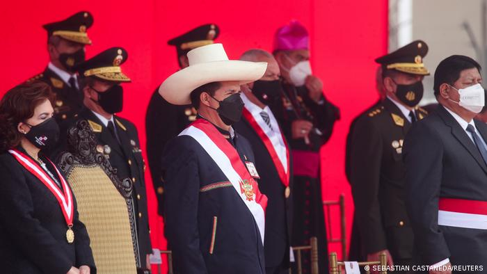 Peru's President Pedro Castillo (C) attends a ceremony for Armed Forces Day alongside Supreme Court President Elvia Barrios Alvarado (L) and Defense Minister Walter Ayala Gonzales, in Lima