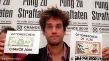 Der Theatermacher Christoph Schlingensief zeigt am Montag (31.8.98) auf einer Pressekonferenz in Berlin Optionsscheine für seine Partei Chance 2000. Die Protestpartei des Aktionisten war in finanzielle Schwierigkeiten geraten, die nach Angaben von Schlingensief inzwischen behoben werden konnten. dpa