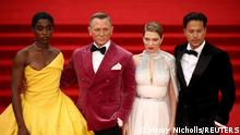 Cast members Lashana Lynch, Daniel Craig, Lea Seydoux and director Cary Fukunaga pose during the world premiere of the new James Bond film No Time To Die at the Royal Albert Hall in London, Britain, September 28, 2021. REUTERS/Henry Nicholls