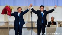 Former Japanese Foreign Minister Fumio Kishida celebrates with outgoing Prime Minister, Yoshihide Suga, after being announced the winner of the Liberal Democrat Party leadership election in Tokyo, Japan September 29, 2021. Carl Court/Pool via REUTERS