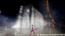 A model presents a creation by designer Anthony Vaccarello as part of his Spring/Summer 2022 women's ready-to-wear collection show for fashion house Saint Laurent during Paris Fashion Week, in Paris, France, September 28, 2021. REUTERS/Stephane Mahe