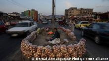 An Afghan man sells fruit in the middle of a street in Kabul, Afghanistan, Wednesday, Sept. 22, 2021. (AP Photo/Bernat Armangue)