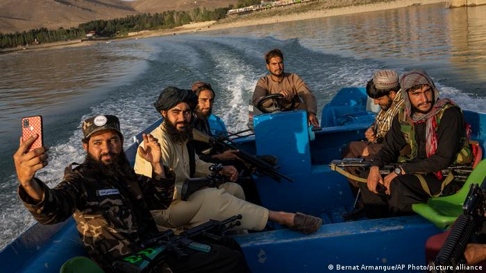 Taliban fighters on a boat