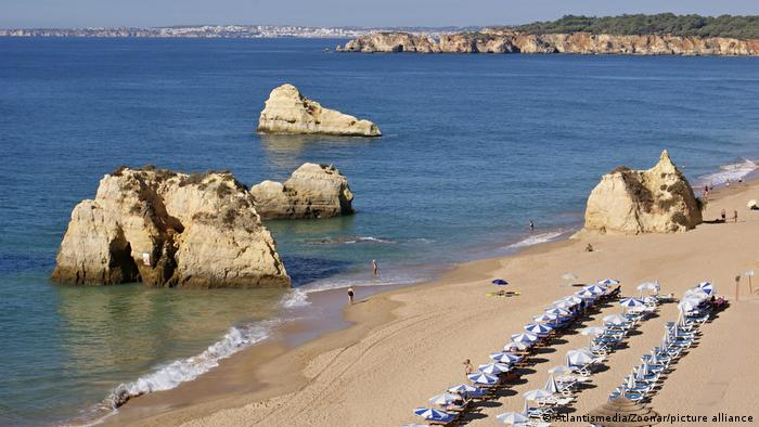 A beach with rows of umbrellas in Portugal