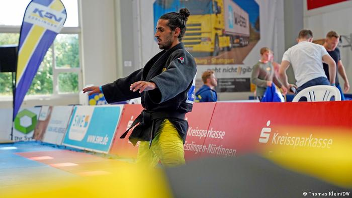 Blind judoka Shugaa Nashwan warming up before a judo match