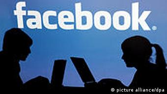 facebook logo with silhouette of poeple on laptops