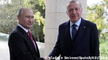 Russian President Vladimir Putin shakes hands with Turkish President Tayyip Erdogan during a meeting in Sochi, Russia September 29, 2021. Sputnik/Vladimir Smirnov/Pool via REUTERS ATTENTION EDITORS - THIS IMAGE WAS PROVIDED BY A THIRD PARTY.