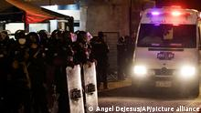 An ambulance leaves from the Litoral penitentiary after a riot, in Guayaquil, Ecuador, Tuesday, Sept. 28, 2021. A police and military operation managed to regain control of the regional prison after five hours, according to a statement from Ecuador's prison service, but reported at least 24 dead and 48 injured during the riot. (AP Photo/Angel DeJesus)
