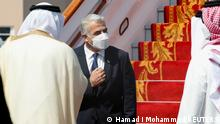 30.09.21 *** Israeli Foreign Minister Yair Lapid is received by Bahrain's Foreign Minister Abdullatif Al-Zayani upon his arrival at Bahrain International Airport in Muharraq, Bahrain, September 30, 2021. REUTERS/Hamad I Mohammed