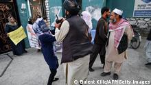 30.09.21 *** A woman protestor scuffles with a member of the Taliban during a demonstration outside a school in Kabul on September 30, 2021. (Photo by BULENT KILIC / AFP) (Photo by BULENT KILIC/AFP via Getty Images)
