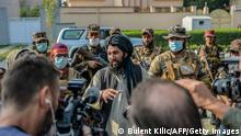 30.09.21 *** A Taliban commander (C) speaks to the members of the media after they halted a demonstration by women protestors happening in front of a school in Kabul on September 30, 2021. (Photo by BULENT KILIC / AFP) (Photo by BULENT KILIC/AFP via Getty Images)