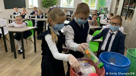 Children are learning how to separate waste responsibility.