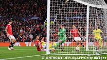 Villarreal's Spanish forward Paco Alcacer (3L) scores the opening goal past Manchester United's Spanish goalkeeper David de Gea during the UEFA Champions league group F football match between Manchester United and Villarreal at Old Trafford stadium in Manchester, north west England, on September 29, 2021. (Photo by Anthony Devlin / AFP) (Photo by ANTHONY DEVLIN/AFP via Getty Images)