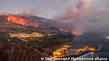 Lava from a volcano reaches the sea on the Canary island of La Palma, Spain, Wednesday Sept. 29, 2021. Lava from a volcano on Spain's Canary Islands has finally reached the Atlantic Ocean after days of wiping out hundreds of homes and forcing the evacuation of thousands of residents. (AP Photo/Saul Santos)
