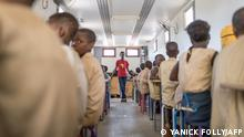 Schoolchildren from Avrankou-Houeze school attend a training in the BloLab container at Avrankou city hall, in Avrankou, south of Benin, on January 18, 2019. - Designed by BloLab, a non-profit group, the 13-metre (43-foot) trailer is powered by 12 solar panels and equipped with enough laptops to give students in the countryside a chance to familiarise themselves with computers, which most families cannot afford. Indeed, Benin's internet penetration rate is just 42.2 percent, the Regulatory Authority for Electronic and Postal Communication said in a report published last year. (Photo by Yanick Folly / AFP)
