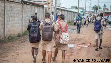 Students walk towards the General Education College (CEG) in Godomey, as school resumes on May 11, 2020. - Schools in Benin reopened on Monday, with strict instructions on distance, hygiene and distribution of masks, after several weeks of closure to curb the spread of the new coronavirus. (Photo by Yanick Folly / AFP)