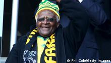 11/06/2010*** JOHANNESBURG, SOUTH AFRICA - JUNE 11: Archbishop Desmond Tutu (L) and Vice President of the United States Joe Biden attend the 2010 FIFA World Cup South Africa Group A match between South Africa and Mexico at Soccer City Stadium on June 11, 2010 in Johannesburg, South Africa. (Photo by Phil Cole/Getty Images)