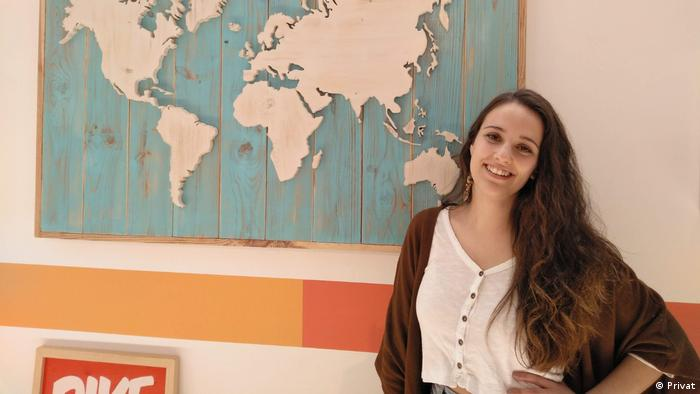 Carmen Quintana Gómez with card, hopes to travel abroad for work