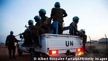 Peacekeeper troops from Ethiopia and deployed in the United Nations (UN) Interim Security Force for Abyei (UNISFA) patrol in a UN vehicle at night in Abyei town, Abyei state, on December 14, 2016. The Abyei Administrative Area is a disputed territory between Sudan and South Sudan with a longstanding intercommunal tensions between the Ngok-Dinka ethnic majority and the pastoral Misseriya population, who migrate through the area seasonally from the north. An attack by Government of Sudan forces on Abyei in May 2011 displaced the majority of the Ngok Dinka population, approximately 105,000 people to areas south of the River Kiir, which became overcrowded and are suffering a huge competition over natural resources. / AFP / Albert Gonzalez Farran (Photo credit should read ALBERT GONZALEZ FARRAN/AFP via Getty Images)