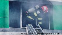 In this image released by Romania's Emergency Situations Inspectorate, a firefighter works to put out a blaze at the COVID-19 ICU section of the Hospital for Infectious Diseases in the Black Sea port of Constanta, Romania, Friday, Oct. 1, 2021. Authorities say a fire at a hospital in Romania's port city of Constanta has killed at least nine people. All patients have been evacuated following Friday's blaze at Constanta's Hospital for Infectious Diseases. (Romanian Emergency Situations Inspectorate, IGSU via AP)