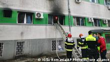 In this image released by Romania's Emergency Situations Inspectorate, firefighters put out a blaze at the COVID-19 ICU section of the Hospital for Infectious Diseases in the Black Sea port of Constanta, Romania, Friday, Oct. 1, 2021. Authorities say a fire at a hospital in Romania's port city of Constanta has killed at least nine people. All patients have been evacuated following Friday's blaze at Constanta's Hospital for Infectious Diseases. (Romanian Emergency Situations Inspectorate, IGSU via AP)