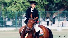Fatima Rezavi riding horse