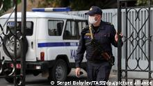 MINSK, BELARUS - SEPTEMBER 2, 2020: A police officer closes the gates outside the Directorate of Internal Affairs (RUVD) for Oktyabrsky District, where detained journalists covering an unauthorised protest are kept. Sergei Bobylev/TASS