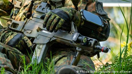 Bundeswehr soldier (no face shown) holding a weapon