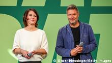 BERLIN, GERMANY - OCTOBER 02: German Greens Party co-leaders Annalena Baerbock and Robert Habeck (R) attend a meeting of the Greens Party states council (Länderrat) on October 2, 2021 in Berlin, Germany. The meeting is taking place as the Greens begin exploratory talks with the German Social Democrats (SPD), the Free Democrats (FDP) and the Christian Democrats (CDU/CSU) over the possible constellation of the next German federal government coalition. The Greens finished in third place in Germany's recent election and are certain to be a member of the next coalition government. (Photo by Omer Messinger/Getty Images)
