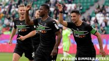 Soccer Football - Bundesliga - VfL Wolfsburg v Borussia Moenchengladbach - Volkswagen Arena, Wolfsburg, Germany - October 2, 2021 Borussia Moenchengladbach's Breel Embolo celebrates scoring their first goal with teammates REUTERS/Fabian Bimmer DFL regulations prohibit any use of photographs as image sequences and/or quasi-video.