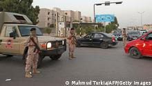 Libyan soldiers man a checkpoint southeast of the capital Tripoli, on September 4, 2021, after clashes near the Tekbali barracks, the headquarters of 444 Brigade. - Two Libyan army units used heavy artillery in an exchange of fire overnight centring on a barracks in a densely populated area of southeast Tripoli, the military command said. (Photo by Mahmud TURKIA / AFP) (Photo by MAHMUD TURKIA/AFP via Getty Images)