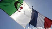 People wave the French and Algerian flags during a demonstration against a municipal order banning the conspicuous showing of foreign flags issued by French right-wing UMP mayor of Nice Christian Estrosi (not pictured), following Algeria's fans celebrations during the 2014 FIFA World Cup, on July 05, 2014, in Nice, southeastern France. The French courts have suspended the controversial order on July 4, 2014, deeming it disproportionate. AFP PHOTO / VALERY HACHE (Photo credit should read VALERY HACHE/AFP via Getty Images)