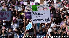 Demonstrators hold signs during the Women's March rally at Freedom Plaza, in Washington, Saturday, Oct. 2, 2021. (AP Photo/Jose Luis Magana)
