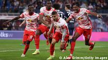 LEIPZIG, GERMANY - OCTOBER 02: André Silva of Leipzig celebrates scoring his team's first goal with Amadou Haidara, Nordi Mukiele and Mohamed Simakan during the Bundesliga match between RB Leipzig and VfL Bochum at Red Bull Arena on October 02, 2021 in Leipzig, Germany. (Photo by Alex Grimm/Getty Images)