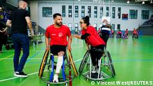 Afghan national women's wheelchair basketball team captain Nilofar Bayat and her husband Ramesh Naik Zai talk ahead of their debut game for mixed-gender team Bidaideak against Fundacion Vital Zuzenak, in Amurrio, Spain, October 2, 2021. REUTERS/Vincent West